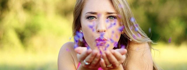 Female Blowing Purple Flowers 1280x480